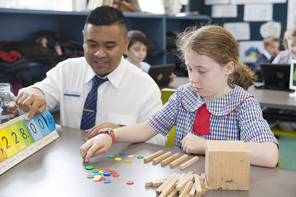 St Pius Catholic Primary School Enmore - teacher and student at learning Facility
