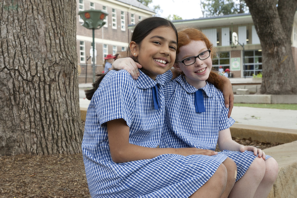 St Pius Catholic Primary School Enmore - students sitting on bench at school
